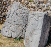 Rocks Monte Alban Archaeological site Oaxaca Mexic. The ancient figures and art of archaeological site of Monte Alban, Oaxaca State, Mexico Royalty Free Stock Photos