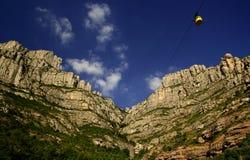 Rocks of Montserrat. The yellow cab to monastery Montserrat Stock Photo