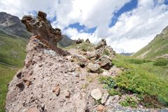 Rocks in mountain grass valley, Caucasus mountains Stock Photos