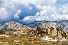 Rocks, mountain peaks, and beautiful clouds of Australian Alps Stock Images