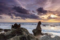 Rocks on the muddy beach in Cadiz. Rocky beach with storm clouds in Cadiz Stock Image