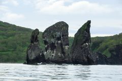 The rocks are named `Three Brothers`, near the coast of pacific ocean royalty free stock photography