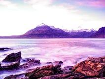 Rocks near Elgol,  Loch Scavaig,  Isle of Skye Scotland. Warm sunset in February evening. Rocks near Elgol,  Loch Scavaig,  Isle of Skye Scotland. Warm sunset Stock Images