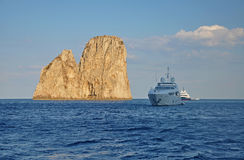 The rocks near the island of Capri and ships Royalty Free Stock Images