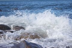 Rocks near the Portugese sea, water rising. Rocks near the portugese sea, water is rising and smashing to the rocks stock images