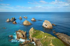 Rocks at point nugget in New Zealand Stock Photos