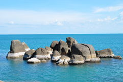 Rocks in ocean Stock Photography