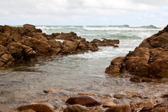 Rocks in the ocean Stock Photography