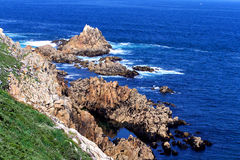Rocks in the ocean. View of rocks in the ocean from up a cliff stock photos