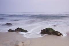 Rocks in Ocean. Rocks in pacific ocean with swirling water royalty free stock photos