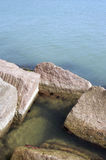Rocks and Ocean. Large boulders on shore bathed by ocean water Stock Photos