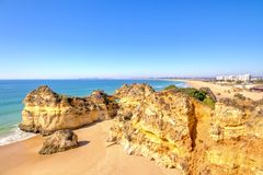Rocks and ocean in the Algarve Portugal. Rocks and ocean at Praia Tres Irmaos in Alvor Algarve Portugal Stock Image