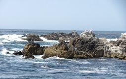 Rocks and the ocean are beautiful at Monterrey Bay. Stock Photos