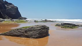 Rocks and ocean at Praia Vale Figueiras in Portugal. Europe royalty free stock images