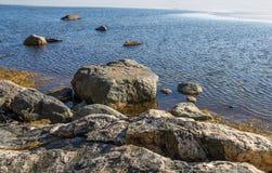 Rocks in the ocean shore. Rocks in the icy ocean shore Stock Images