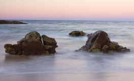 Rocks by ocean shoreline Royalty Free Stock Photography