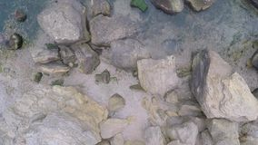 Rocks in the ocean, viewed from above stock video footage