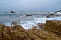 Rocks and ocean waves Stock Photography