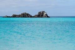 Rocks Off The Galapagos Islands. Lava rocks forming a small island in the Galapagos Islands stock photography