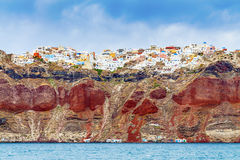 Rocks with Oia on Santorini Royalty Free Stock Image
