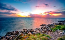 Free Rocks On Stone Beach At Sunset. Beautiful Landscape Of Calm Sea. Tropical Sea At Dusk. Dramatic Colorful Sunset Sky And Cloud. Royalty Free Stock Photography - 163060107