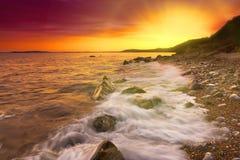 Rocks at Osmington Reflecting Sunset Colours Stock Photos