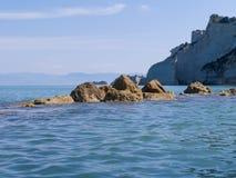 Rocks outside the Corfu ocean shore Stock Photos
