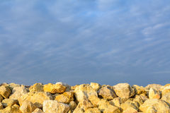Rocks over blue clear sky. Backgroung with clear blue sky meetin Stock Images