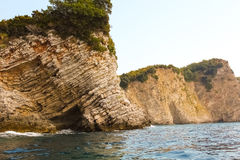 Rocks over the transparent ocean water Royalty Free Stock Images