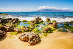 Rocks, and Pacific ocean waves on the island of Maui Royalty Free Stock Image