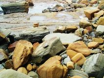 Rocks on pacific shoreline Stock Images