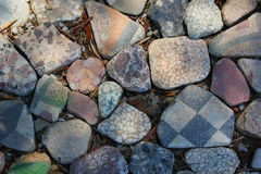 Rocks. Painted and unusual stones on the floor Stock Images