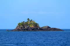 Rocks and palm treest in a tropical island, Fiji royalty free stock photography