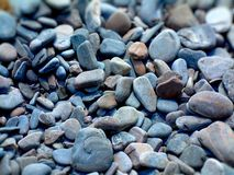 Rocks and Pebble Abstract. Abstract Pebble, Rock, Stone Background on beach near Rock Pools Stock Image