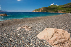 Rocks and pebble beach at Bussaglia on west coast of Corsica Stock Photography
