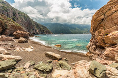 Rocks and pebble beach at Bussaglia on west coast of Corsica Royalty Free Stock Photo