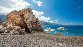Rocks and pebble beach at Bussaglia on west coast of Corsica Royalty Free Stock Photos