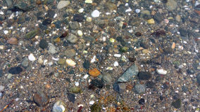 Rocks and pebbles in the sea stock photo