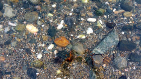 Rocks and pebbles in the sea Royalty Free Stock Images
