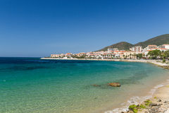 The rocks and pebbles of the shoreline in Ajaccio in Corsica royalty free stock photography