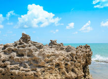 Rocks pierced by the waves of the sea. Stock Photography