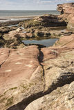 Rocks, pools and cliff at Hilbre Island, Wirral, England Stock Photos