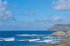 Rocks in Porto Palmas. Blue wavy sea in Porto Palmas Stock Photography
