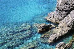 Rocks and the quiet expanse of the Mediterranean Sea royalty free stock photo