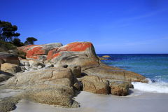 Rocks with red top. Spectacular red rocks on the coast line Royalty Free Stock Photos
