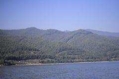 Rocks and river boat. Landscape rocks in the Irkutsk region , the river royalty free stock image
