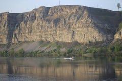 Rocks and river boat. Landscape rocks in the Irkutsk region , the river stock photo