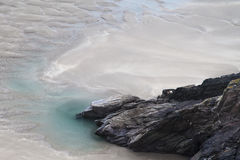 Rocks and Rock Pool on Beach Royalty Free Stock Images