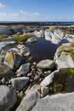 Rocks and rock pools in South Uist Stock Image