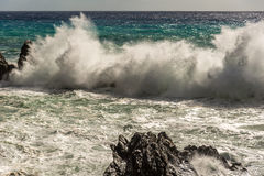 Rocks in rough sea Stock Photography